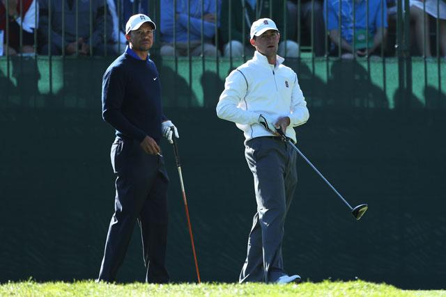 Cameron Wilson watches his tee shot alongside Tiger Woods during a practice roun